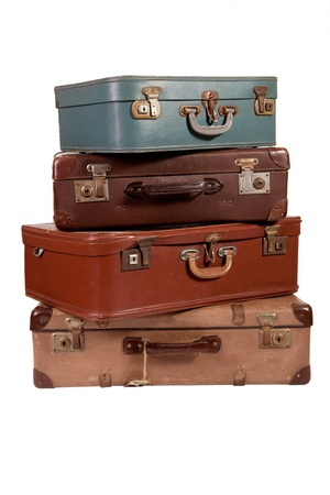 Pile of old suitcase on white backgroud