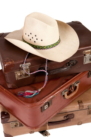 Pile of old suitcase with hat on top on white backgroud Banque d'images