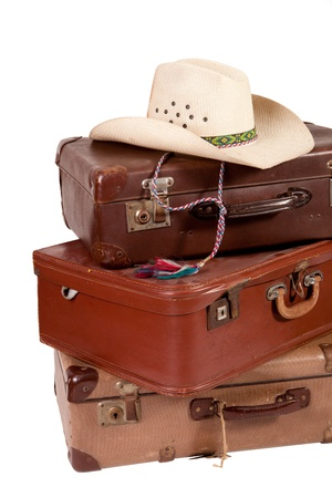 Pile of old suitcase with hat on top on white backgroud Stock Photo