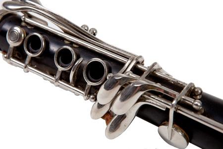 Old clarinet on white background, close up  photo