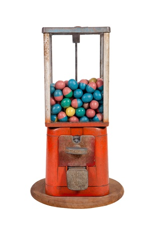 Old dispenser with colorful eggs inside on white background