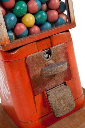 Old dispenser with colorful eggs inside, close up  photo