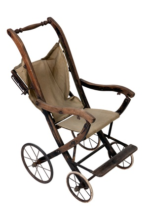 Old vintage styled baby carriage-stroller on white background photo