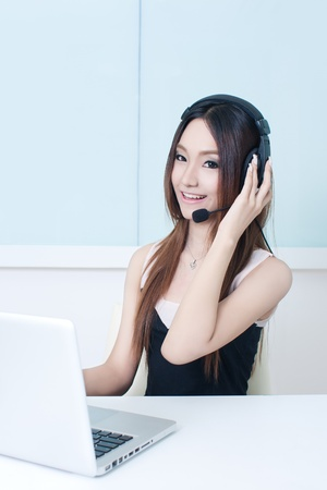 Businesswoman with headphone and laptop photo