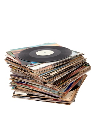 turntable: Pile of old vinyl records on white background