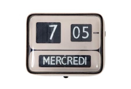 Old flip clock  on white background photo