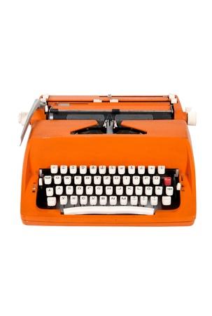 Classic orange typewriter on white background