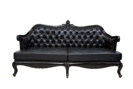 seating furniture: Luxury black leather sofa on white background