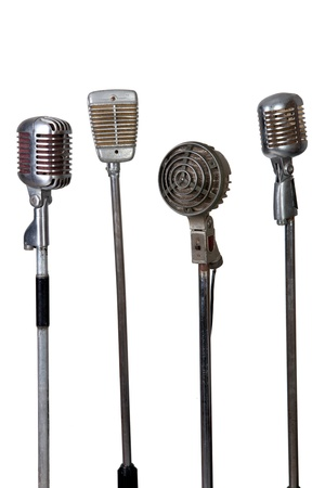 old microphone collection on white background photo