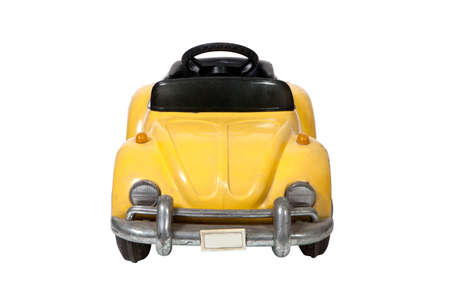 Old vintage yellow toy car on white background photo