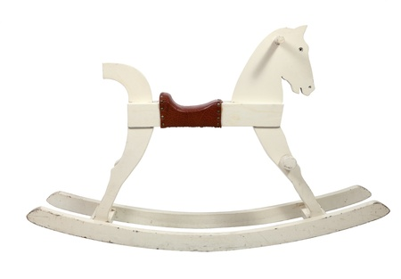 White wooden rocking horse chair children on white background photo