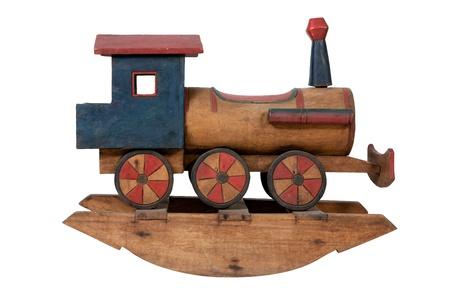 juguetes antiguos: Tren de juguete en el carril en el fondo blanco Foto de archivo