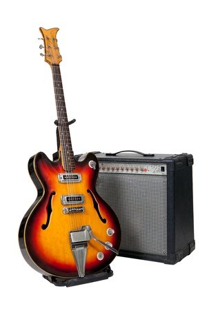 Guitar and amplifier on white background photo