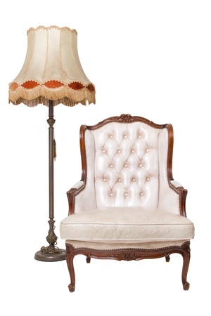 Vintage luxury armchair and lamp on white background