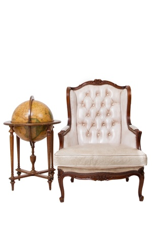Vintage luxury armchair and globe on white background photo
