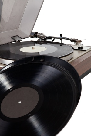 Old wooden vinyl player  with vinyl record, close up photo