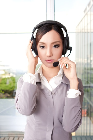 Portrait of young customer representative with headset