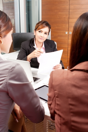 Group of business people discussing in an office