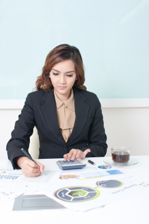Young business woman working on her desk.