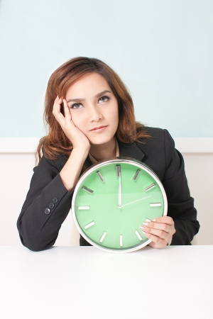 Young business woman is boring to work for another haft day Stock Photo
