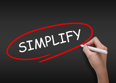 pragmatic: Simplify word drawn by hand on a transparent board Stock Photo