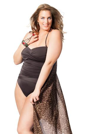 Beautiful plus size model wearing swimsuit and shawl. Stock Photo