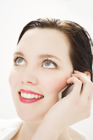 20 24: Cheerful Caucasian woman talking on mobile phone.