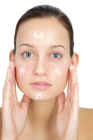 toner: Young woman cleancing her face and applyting lotion. Skincare concept. Stock Photo
