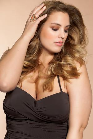 Beautiful plus size model wearing swimsuit.