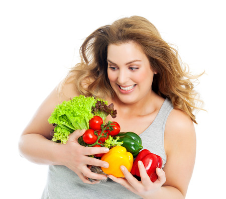 plus size woman: Happy and excited real woman with fresh vegetables. Stock Photo