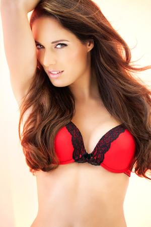red bra: Woman posing in red bra. Stock Photo