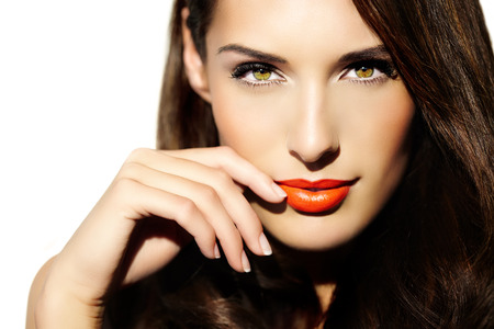 Portrait of a young woman in sunny light with bright lipstick. Banco de Imagens - 35223015