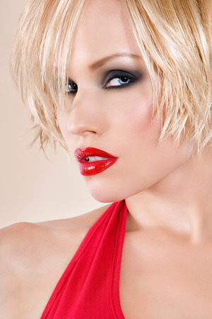 Close-up of models face with bright red lips.
