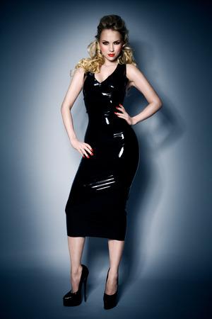 Model wearing black latex dress. Stock Photo