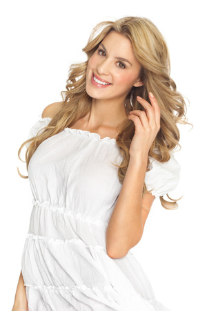 beautiful blonde: Happy beautiful Caucasian blond woman in white summer fashion dress. Stock Photo