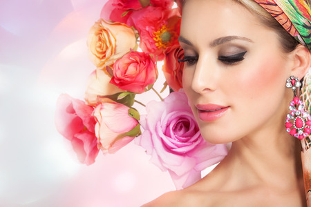 glowing skin: Beautiful spring woman with flowers. Glowing colorful summer fashion concept. Stock Photo