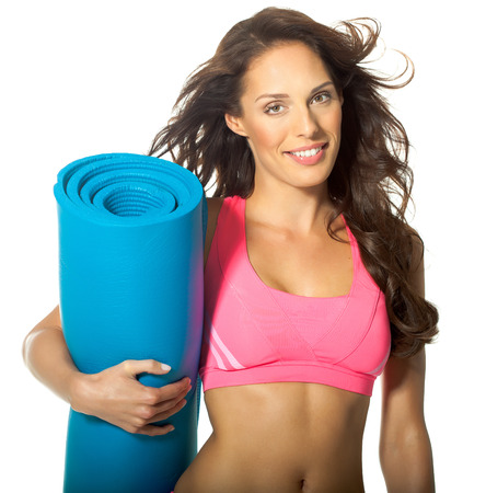 yoga mat: Young woman posing in fitness outfit.
