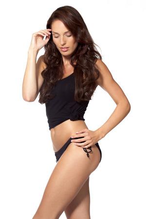 femme en sous vetements: Jeune femme posant en tenue remise en forme.