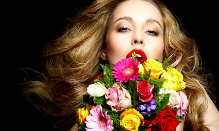 Beautiful girl with lots of flowers. photo
