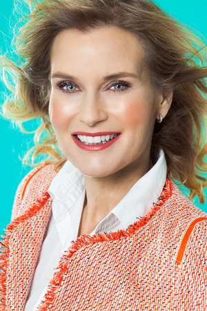 blazer: Elegant woman wearing orange boucle blazer.