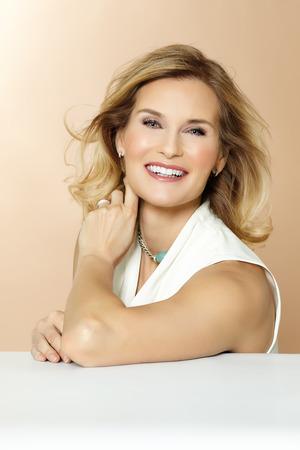 Beautiful polished 40 year old woman.