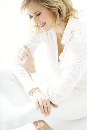 Beautiful sitting woman.