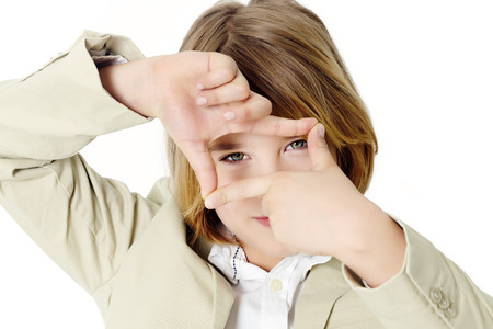 ten year old: Ten year old boy making camera sign with his hands. Stock Photo