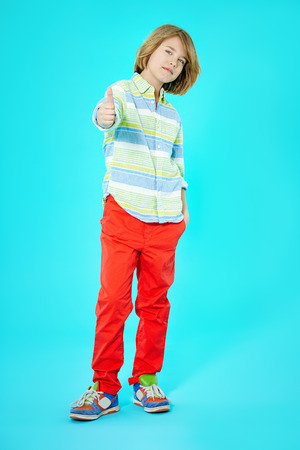 ten year old: Ten year old boy with thumb up approval gesture. Stock Photo
