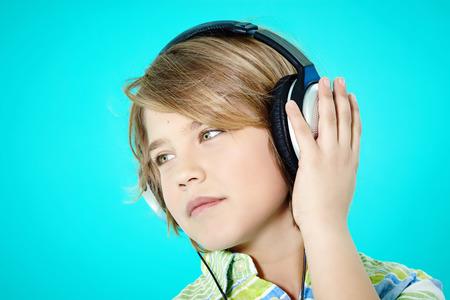ten year old: Ten year old boy wearing headphones.