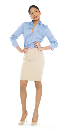 secretary skirt: Beautiful young Indian businesswoman posing on isolated white background.