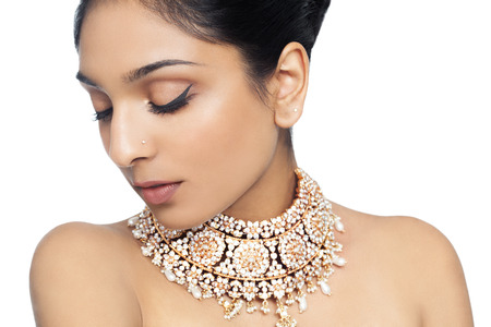 Portrait of an Indian woman wearing traditional jewelry. Stock fotó