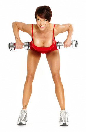 woman short hair: Caucasian woman with short hair on white background wearing red fitness separate and excercising with dumbells.