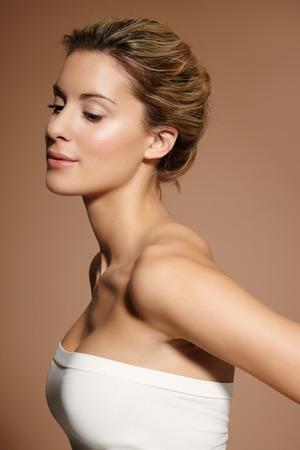 Beautiful natural woman on beige background. Banco de Imagens