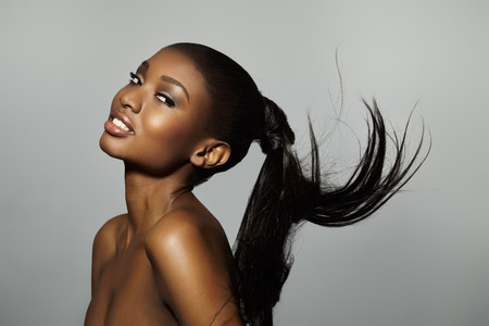 ponytail: African woman with long tail floating.